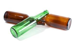 three-empty-beer-bottles-pile-16804845